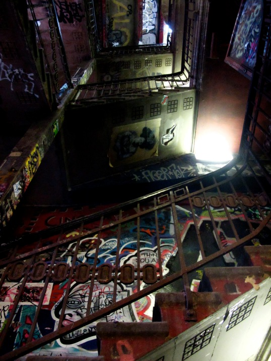 The dark, graffiti-splattered stairwell of Kunsthaus Tacheles, a former art center in Berlin.