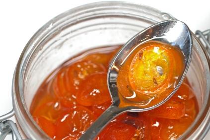 A jar of jewel-like candied kumquats.
