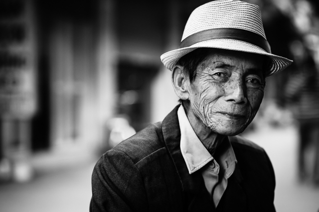 Hanoi street portrait by jon sanwell without an h