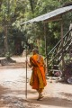 A monk heads to lunch in the Ankgor Wat temple complex, Cambodia.
