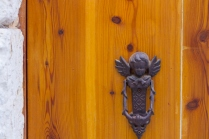 An orange-toned wooden door in Mdina, Malta.