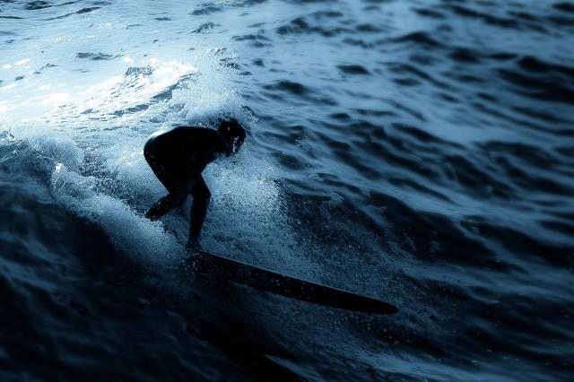 Surfer in San Diego, California. Photo by Brie Anne Demkiw.
