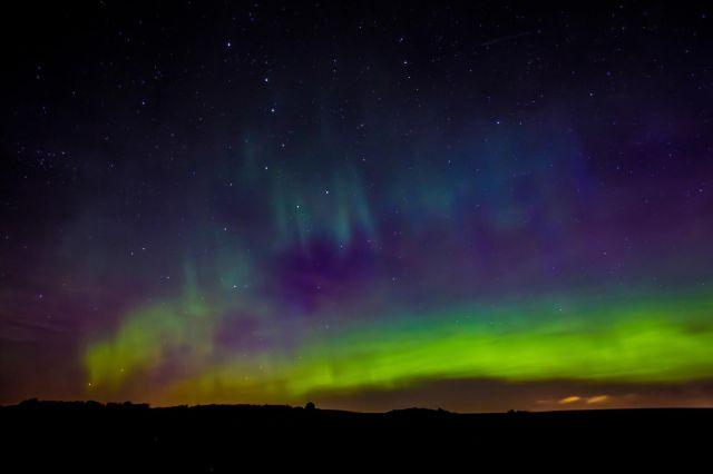 A photo of the Aurora Borealis, by Amandalynn Jones.