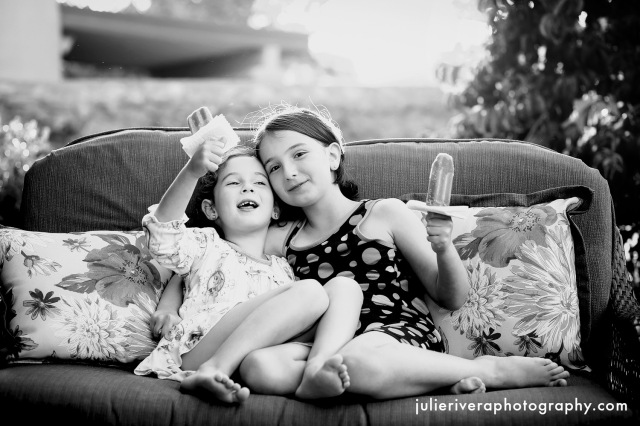 Photo of two girls enjoying popsicles, by Julie Rivera.
