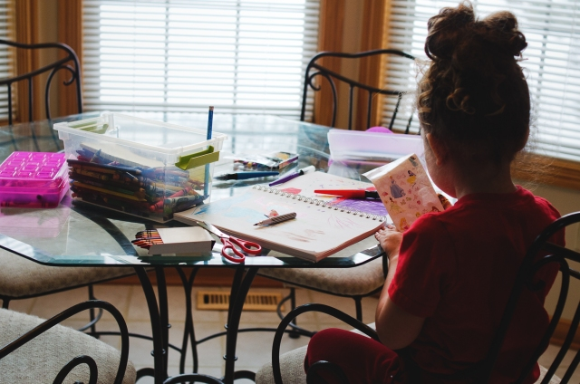 "Future, a photo of a young girl sitting at a table creating art. Photo by <a href=""http://threebirds.blog"" target=""new"">Jen Hooks</a>"
