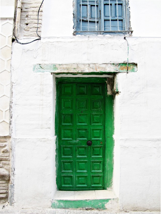 A green door against a white wall in El Albayzín, Granada. Photo by Cheri Lucas Rowlands.