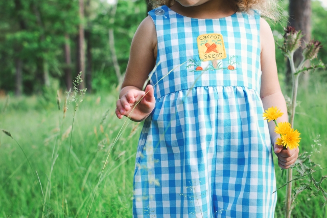 "Pure: a photo of a child picking wildflowers. Photo by <a href=""http://threebirds.blog"">Jen Hooks</a>."