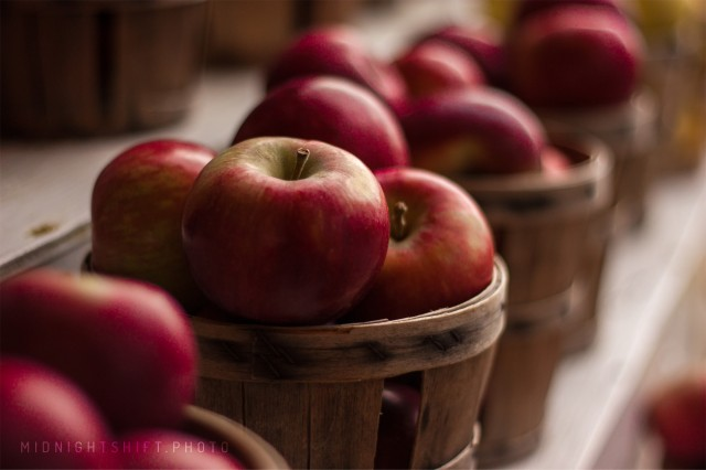 Apples sitting in a basket during autumn in Massachusetts.