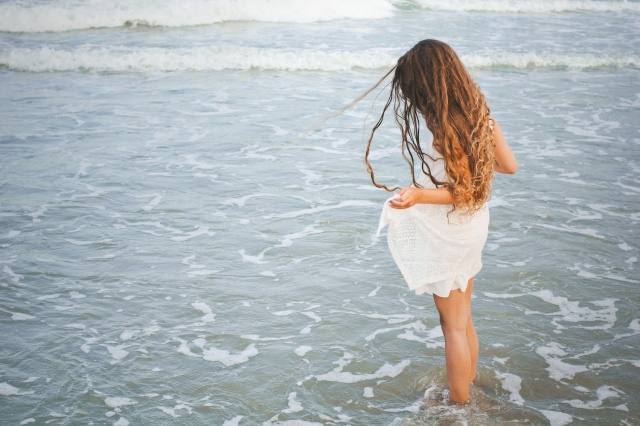 Little girl, big ocean. Photo by Jen Hooks.