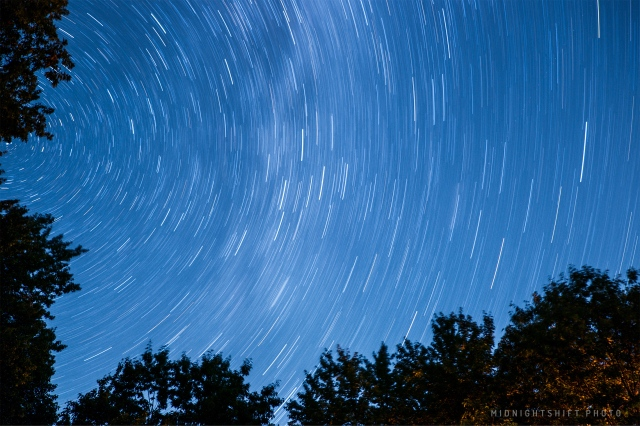 a 28 minute long exposure of the stars above the deep woods of Maine